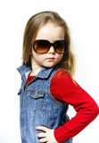 Cute little girl posing in mother's sunglasses, childhood concep Stock Photo