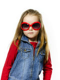 Cute little girl posing in mother's sunglasses, childhood concep Stock Photos