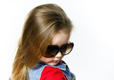 Cute little girl posing in mother's sunglasses, childhood concep Royalty Free Stock Photos