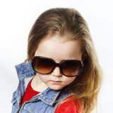 Cute little girl posing in mother's sunglasses, childhood concep Stock Photography