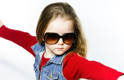 Cute little girl posing in mother's sunglasses, childhood concep Royalty Free Stock Photo