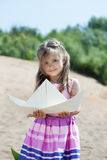 Cute little girl posing with paper boat Stock Images