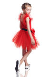 Cute little girl posing in red dress Royalty Free Stock Photography