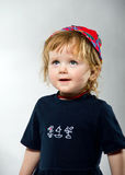 Cute little girl posing in red hat Stock Photography