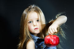 Cute little girl posing with red pomegranate Royalty Free Stock Photography
