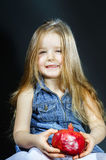Cute little girl posing with red pomegranate Royalty Free Stock Images