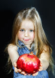 Cute little girl posing with red pomegranate Royalty Free Stock Photos