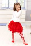 Cute little girl posing in red tutu Stock Images