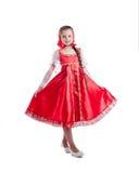 Cute little girl posing in Russian sundress Stock Photos