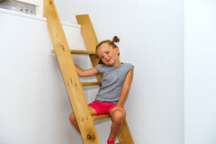 Cute little girl posing on staircase Royalty Free Stock Photography