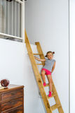 Cute little girl posing on staircase Stock Images
