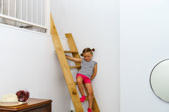 Cute little girl posing on staircase Stock Photo