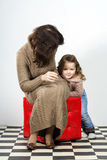 Cute little girl posing in studio with her mother Royalty Free Stock Photo