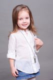 Cute little girl posing in studio Stock Images