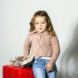 Cute little girl posing in studio stock photos
