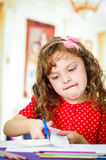 Cute little girl practicing cutting with scissors Royalty Free Stock Photos