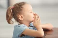 Cute little girl praying at home Stock Photography