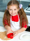 Cute little girl preparing biscuits Royalty Free Stock Image