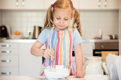 Cute little girl preparing Christmas sweets Stock Images