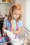Cute little girl preparing Christmas sweets Stock Photo