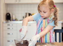 Cute little girl preparing Christmas sweets Stock Photography