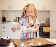 Cute little girl preparing Christmas sweets Royalty Free Stock Photo
