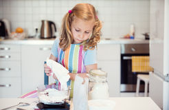 Cute little girl preparing Christmas sweets Stock Photos