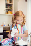 Cute little girl preparing Christmas sweets Royalty Free Stock Photography