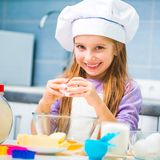 Cute little girl preparing cookies Stock Photo