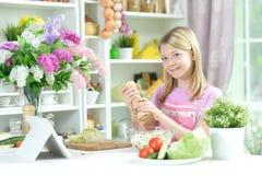 Cute Little Girl Preparing Fresh Salad Royalty Free Stock Images