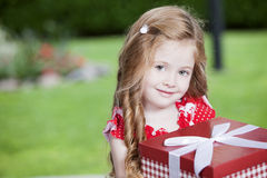 Cute little girl with present Stock Photo