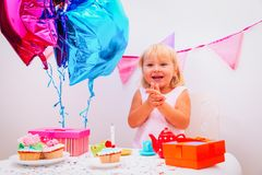 Cute little girl with presents at birthday party. Cute happy little girl with presents at birthday party Royalty Free Stock Photography