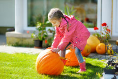 Cute little girl and a pumpkin Stock Images