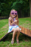 Cute little girl in purple Happy Birthday glasses Royalty Free Stock Photography