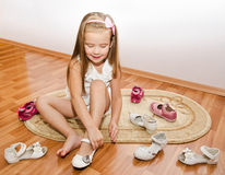 Cute little girl  puts her shoes Stock Photo