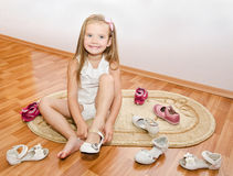 Cute little girl  puts her shoes Royalty Free Stock Image