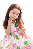 Cute little girl puzzled Royalty Free Stock Photo