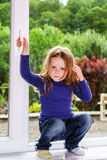 Cute little girl and pvc window Stock Image
