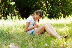 Cute little girl with a rabbit in the garden. Royalty Free Stock Photos
