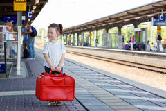 Cute little girl on a railway station. Royalty Free Stock Photos