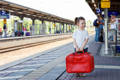 Cute little girl on a railway station. Stock Photo