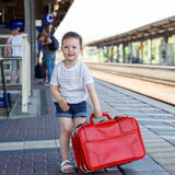Cute little girl on a railway station. Stock Photos