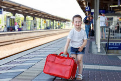 Cute little girl on a railway station. Stock Photography