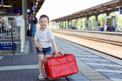 Cute little girl on a railway station. Royalty Free Stock Images