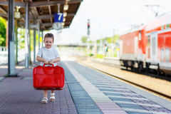 Cute little girl on a railway station. Stock Image