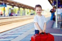 Cute little girl on a railway station. Stock Photos
