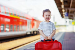 Cute little girl on a railway station. Royalty Free Stock Photo