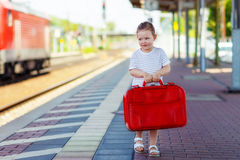 Cute little girl on a railway station. Royalty Free Stock Photography