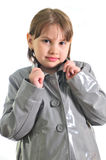 Cute little girl in the raincoat. Isolated over white background Royalty Free Stock Images