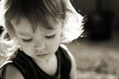 Cute little girl in the rays of sun Royalty Free Stock Photos